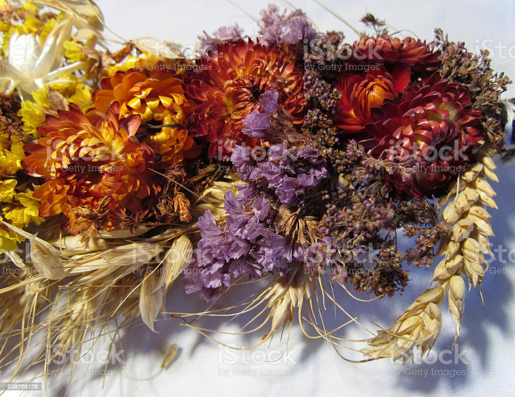 dried flowers, spikelets, poppy tied in a bouquet for the Savior of...
