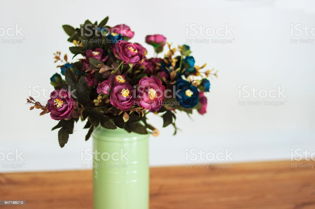 Bouquet Of Dried Flowers In Vase On Table And Light Background A