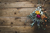 Dried flowers, bouquet, interior, wood grain background