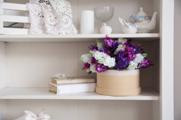 Bouquet of flowers in a box and a book stock photo