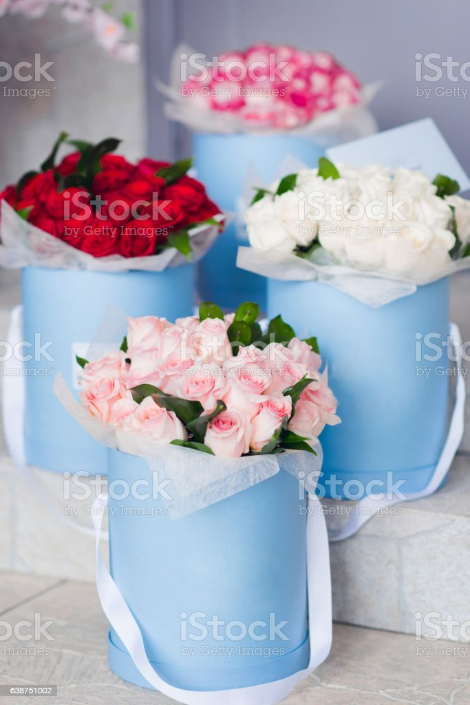 Bouquet of flowers in blue boxes.  Delivery of flowers. stock photo