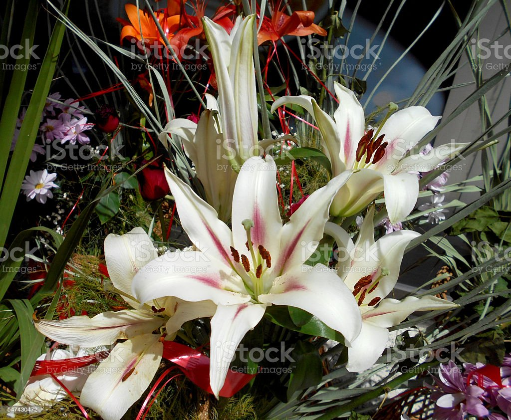 Bouquet made of Lily flowers , Daisies and California Fan Palm leaves...