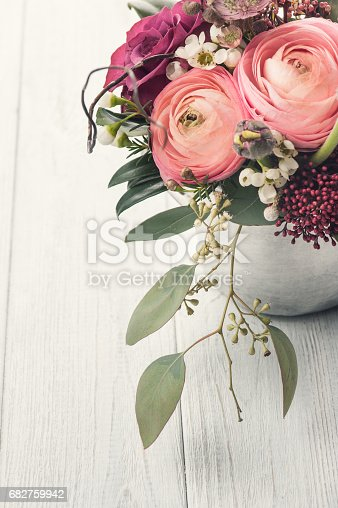 istock Bouquet of flowers in tin mug on light background 682759942