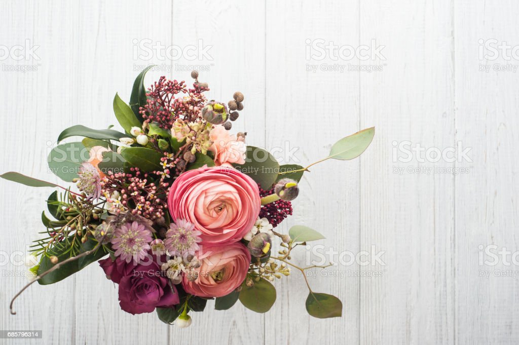 Bouquet of flowers in tin mug on light background stock photo