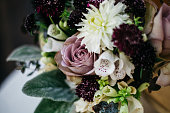 bouquet of beautiful flowers with roses in a small Golden vase in vintage style on the table