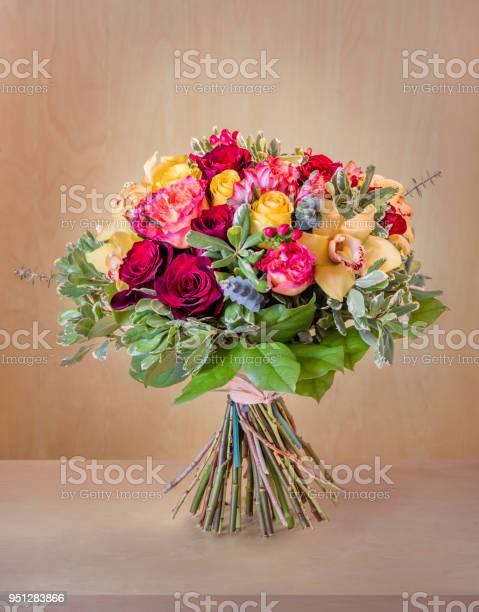 Bouquet of flowers multicolored roses with green leaves stands on a picture id951283866?b=1&k=6&m=951283866&s=612x612&h=m3eua19mb9bhevpznvarmml5eqlbfzu b6irpiim vg=