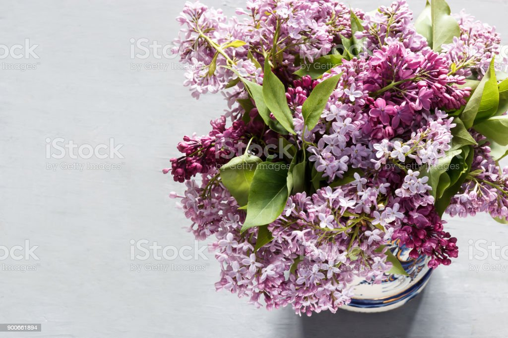 A bouquet of flowers of lilac on a gray concrete background. stock photo