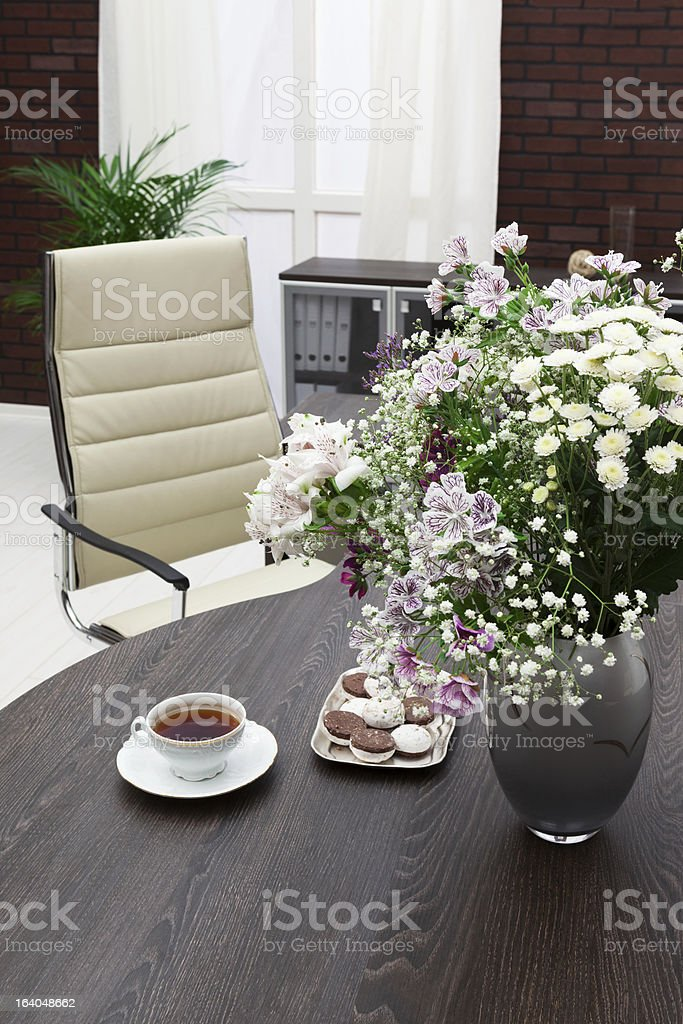 bouquet of flowers on a desk royalty-free stock photo