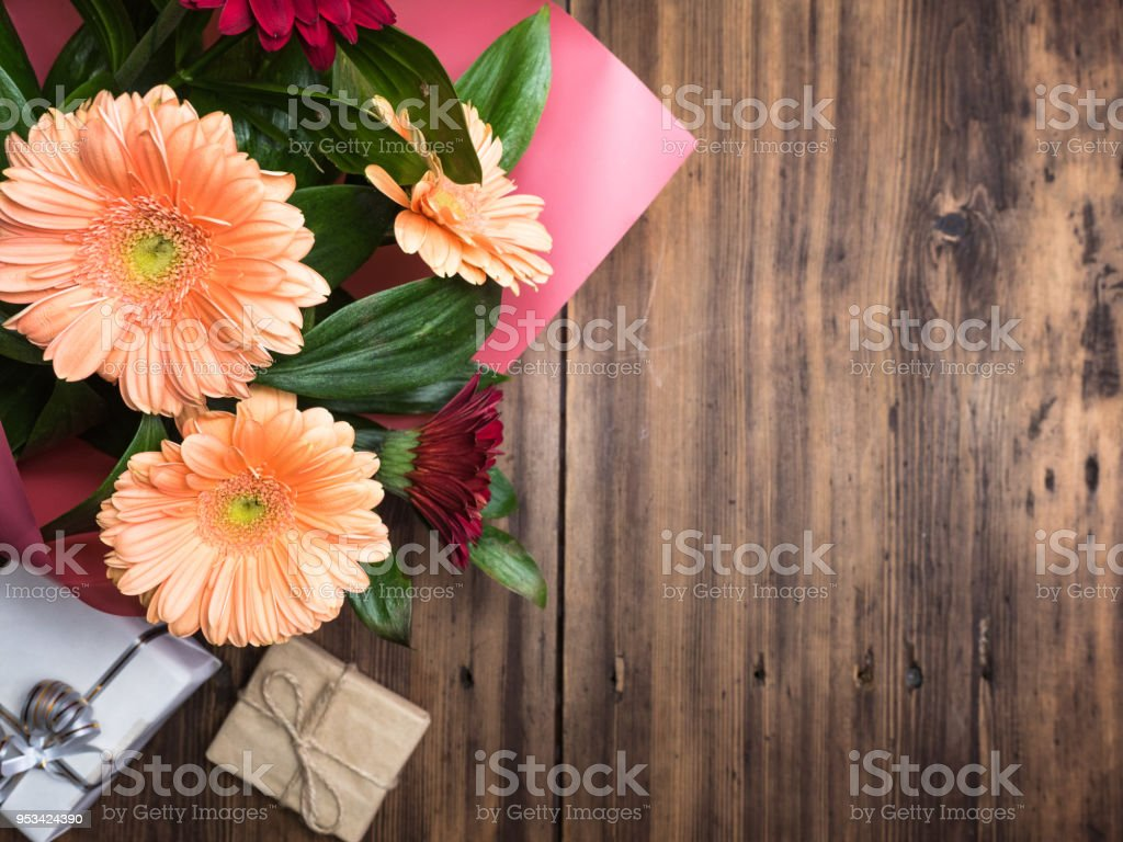 Bouquet of flowers on old wooden background top view decoration with bouquet of flowers on old wooden background top view decoration with gift boxes izmirmasajfo