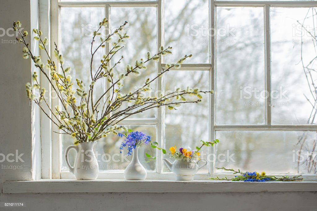 bouquet of flowers on the windowsill stock photo