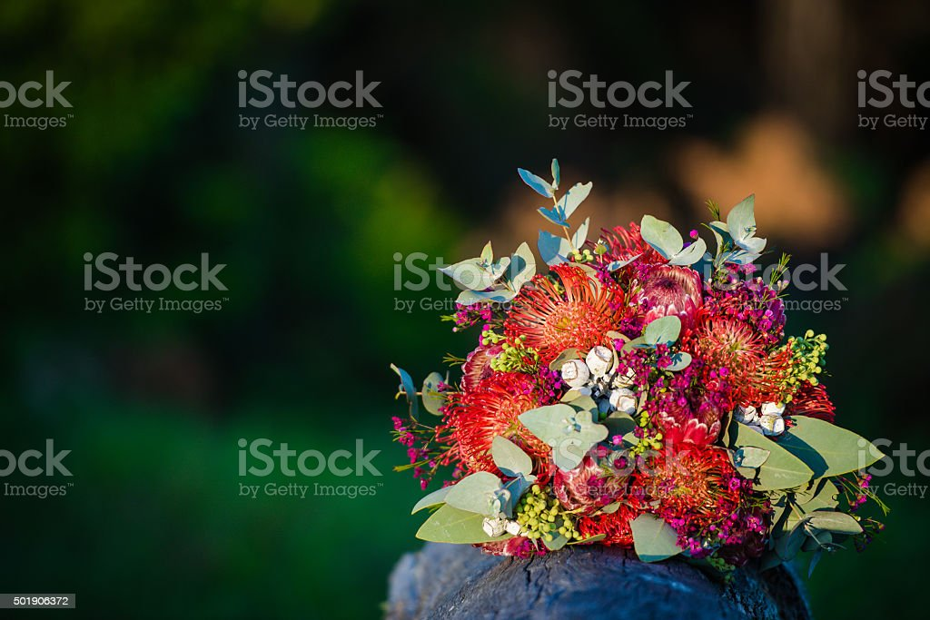 Bouquet of Flowers on wood on dark stock photo