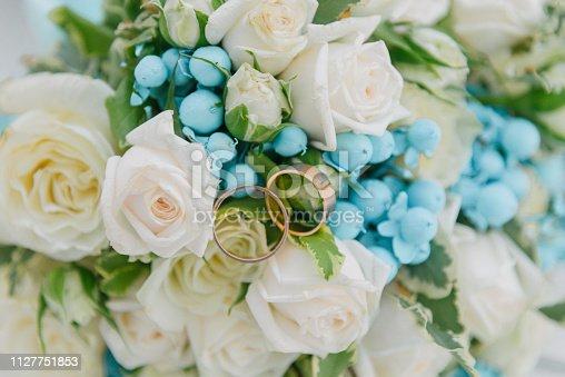 istock Bouquet of flowers. The bride's bouquet. Bridal bouquet. Floristics. Wedding rings. 1127751853