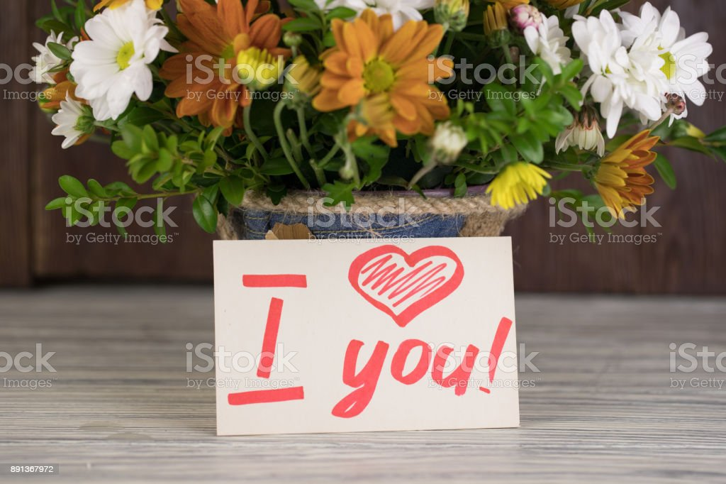 Bouquet of flowers with a note I love you stock photo