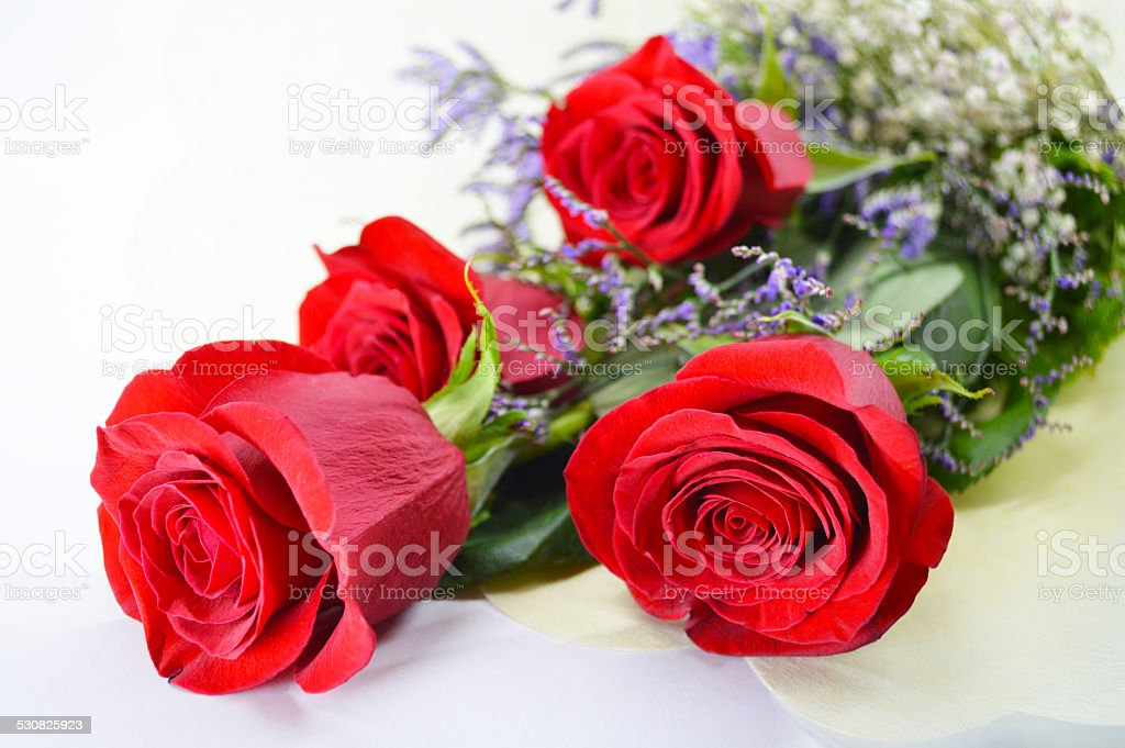 Bouquet of four red roses royalty-free stock photo