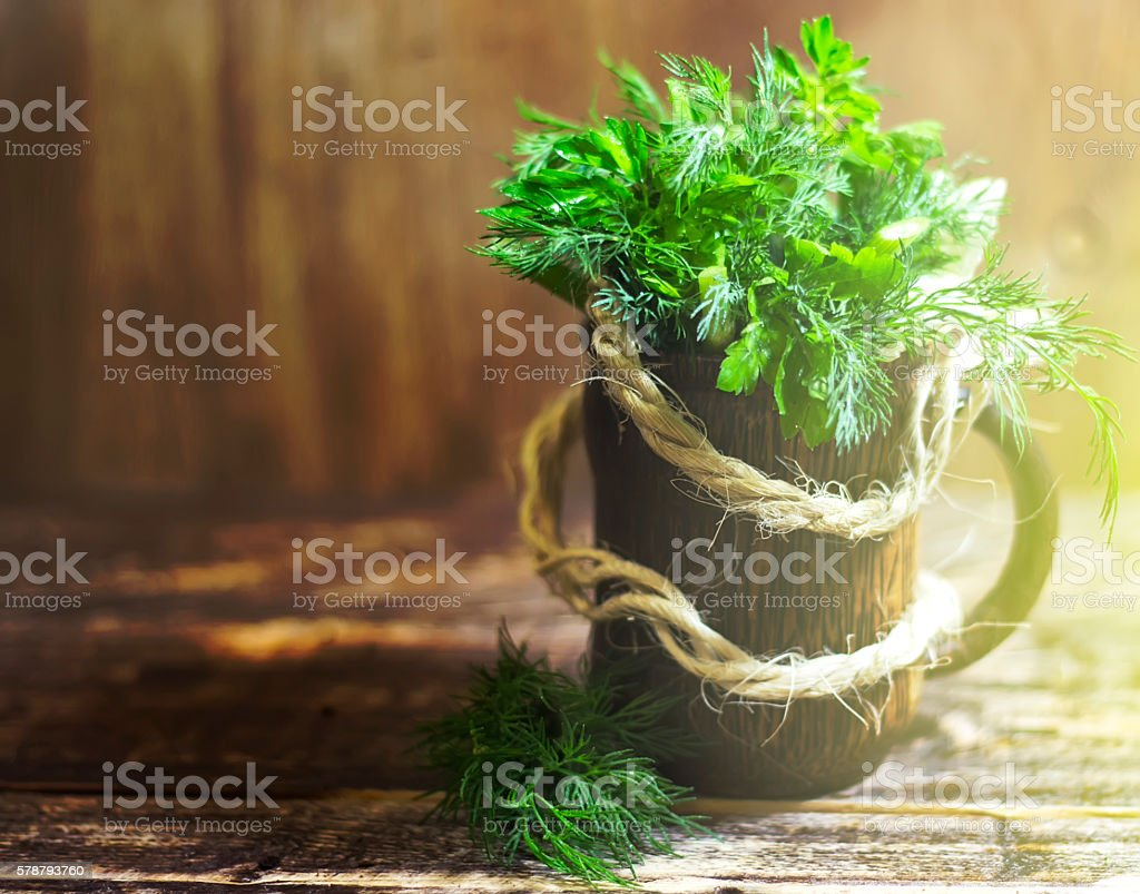 Bouquet of fragrant herbs of fennel and parsley, on a wooden...