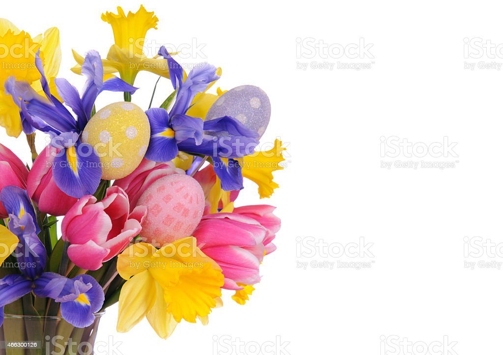 A close up of beautiful bouquet of flowers with eggs on a white...