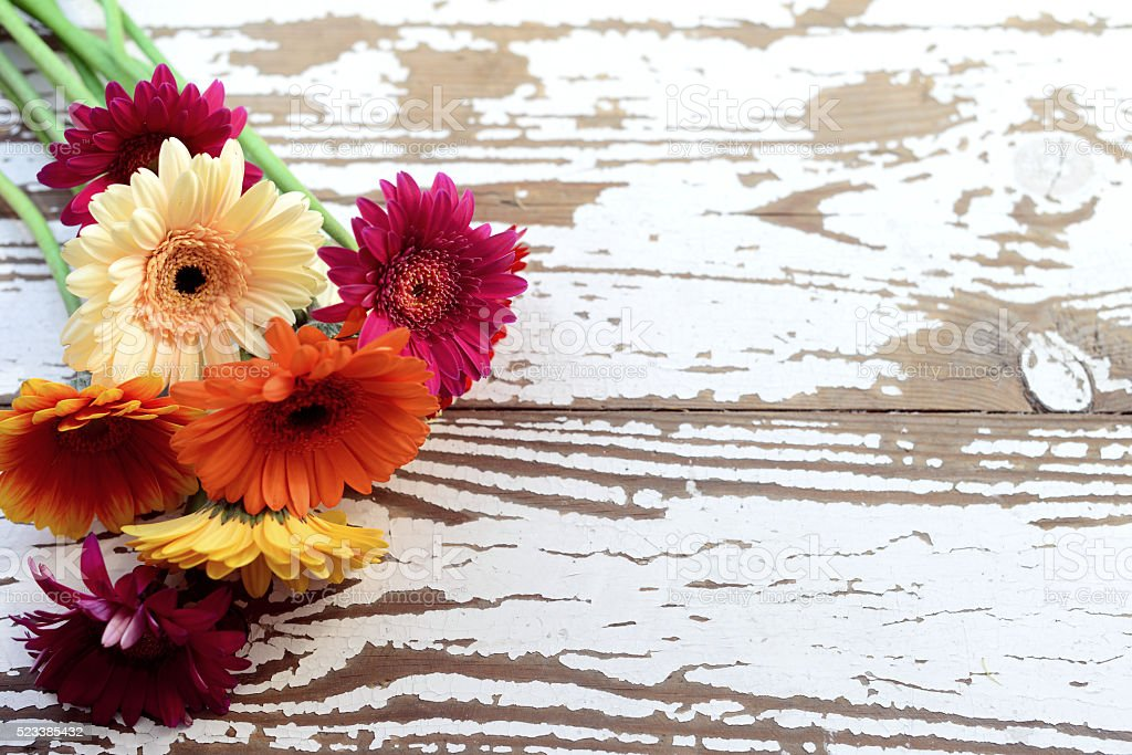 bouquet of gerberas on a wooden background stock photo