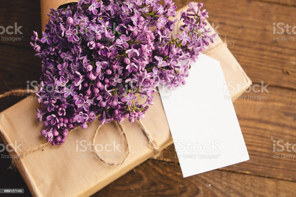 Bouquet of lilacs on a wooden table stock photo