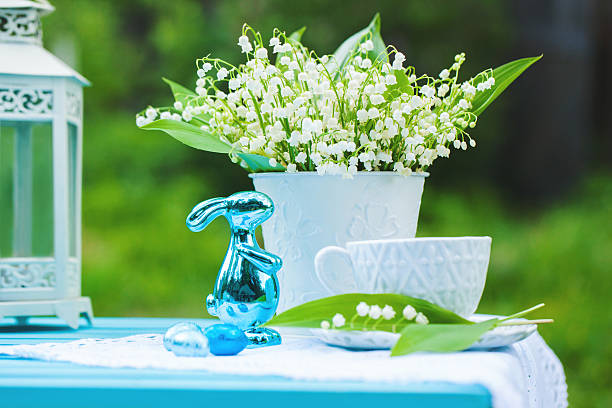Bouquet of lilly-of-the-valley with easter decorations stock photo