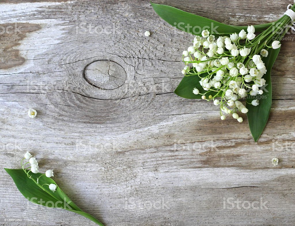 Bouquet of Lily of the valley flowers on wooden background. stock photo