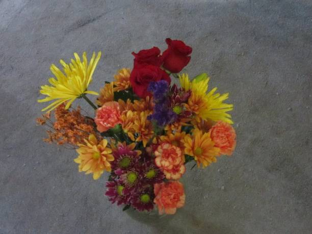 Bouquet of Orange and Red Flowers stock photo