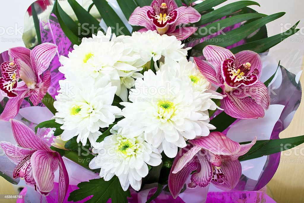 Bouquet of orchids and chrysanthemums isolated on white background royalty-free stock photo