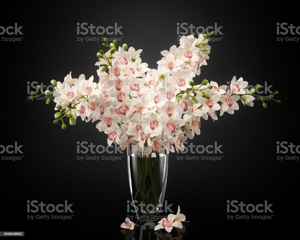 Digitally generated small bouquet of orchids in a glass, isolated on...
