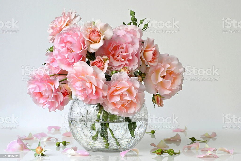 Bouquet of pastel pink roses in a vase. Roses decoration. stock photo