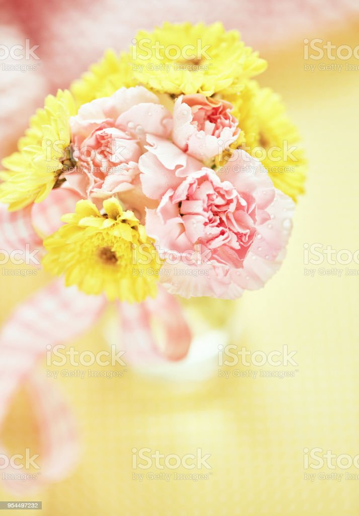Bouquet of pink and yellow flowers in simple glass bottle stock bouquet of pink and yellow flowers in simple glass bottle royalty free stock photo mightylinksfo
