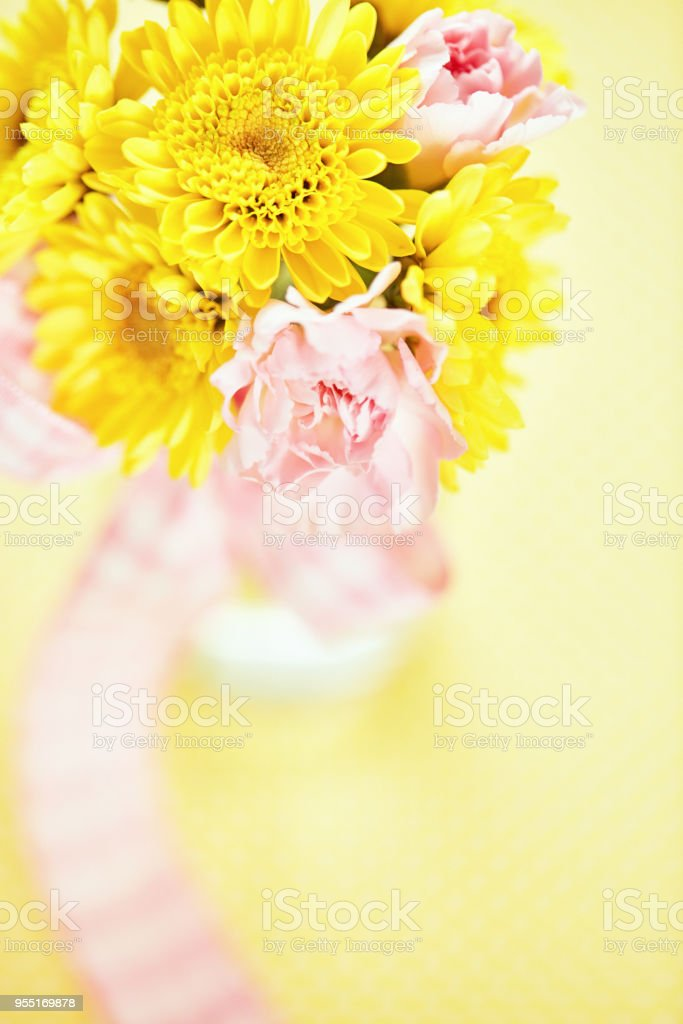 Bouquet Of Pink And Yellow Flowers In Simple Glass Bottle Stock