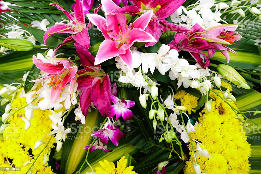 bouquet of pink orchids white lilies for the event closeup stock photo