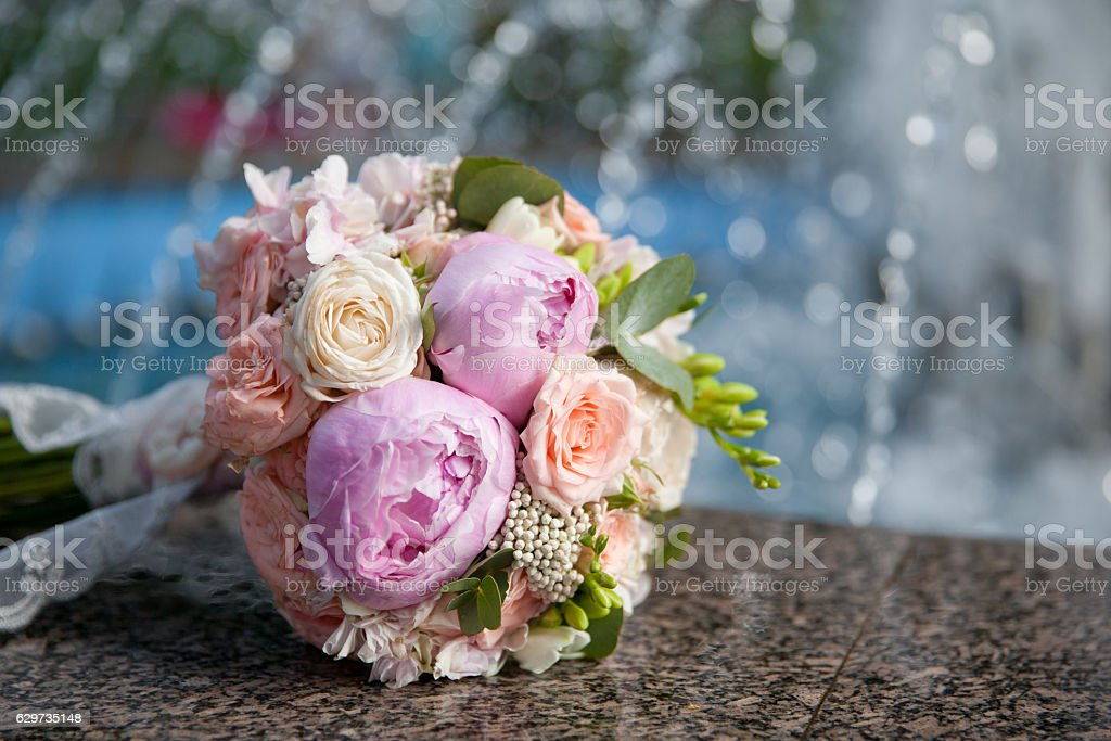 bouquet of pink peonies and roses stock photo