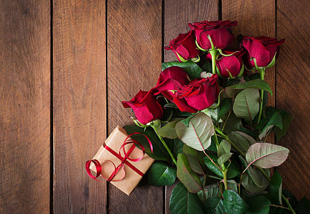 Bouquet of red roses on a dark wooden background picture id495148582?b=1&k=6&m=495148582&s=612x612&w=0&h=cbmb03whaotsvx g3nbw8tttec 6uxwjdp1sxbvclz8=