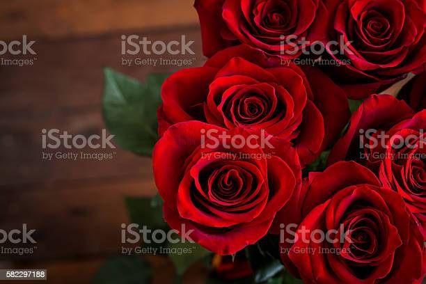 Bouquet of red roses on a dark wooden background picture id582297188?b=1&k=6&m=582297188&s=612x612&h=rqrqbqdhm0iles2yyosjb9qx nhgduw4xnrit32gws0=