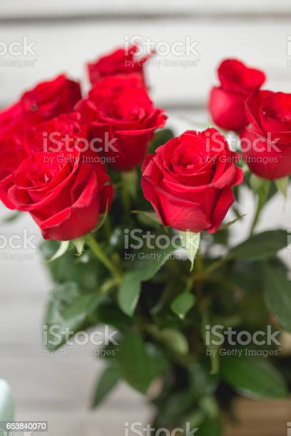 Bouquet of red roses on white wooden background picture id653840070?b=1&k=6&m=653840070&s=612x612&h=v5rjijvxg5zdyte5ypbpzp9w 8 txd9zhfabp diy7k=