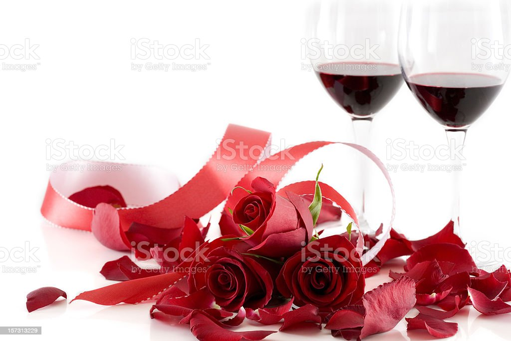 Bouquet of Red Roses, Ribbon, and Wine on White, Copyspace royalty-free stock photo