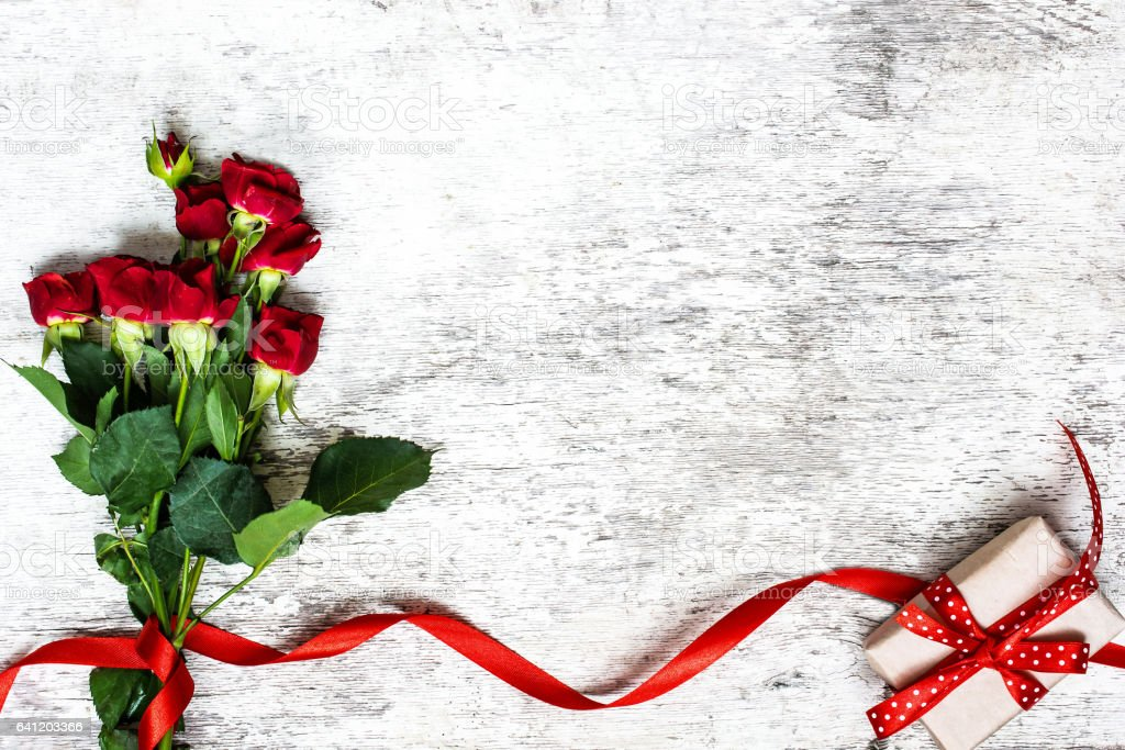 bouquet of red roses with red ribbon and gift box stock photo