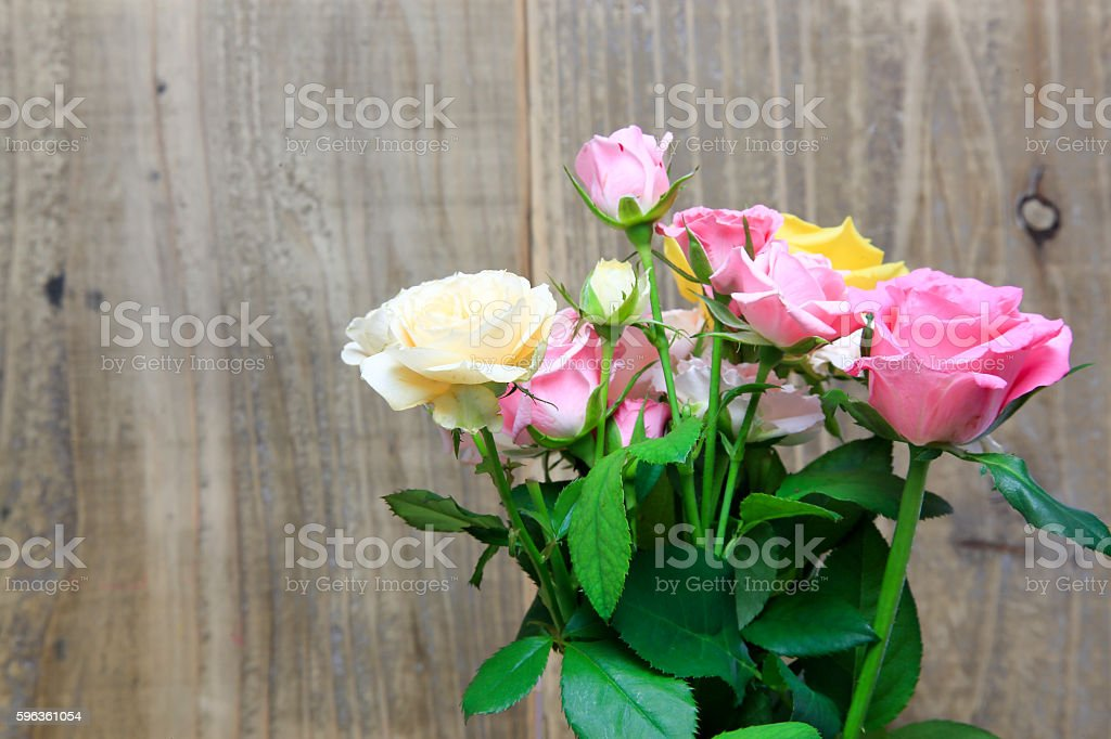 Bouquet of rose in a wooden background royalty-free stock photo