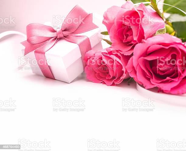 Bouquet of roses and gift box picture id468764493?b=1&k=6&m=468764493&s=612x612&h=twmxu3iwdmt oxyjygn4olmdbea0diyib6utexwpx2k=