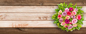 Bouquet of Roses and wooden background