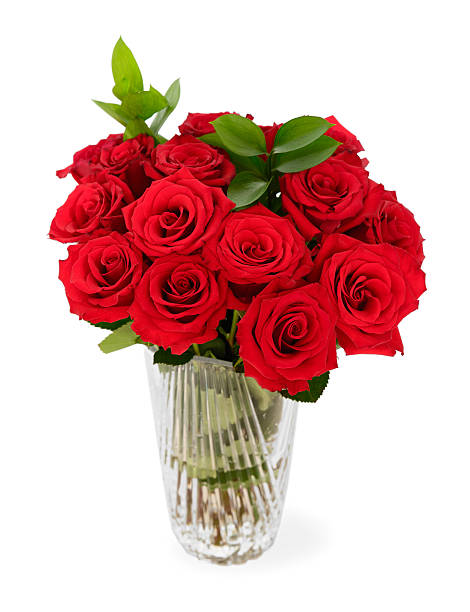 Bouquet of Roses in a Glass Vase. stock photo