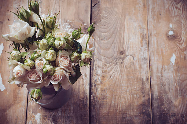 bouquet of roses in metal pot - styles stock photos and pictures