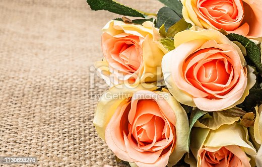 680461500istockphoto Bouquet of roses on rustic background. Mothers day card. 1130693275