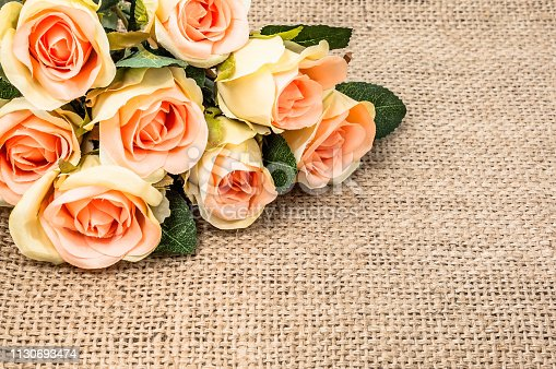 680461500istockphoto Bouquet of roses on rustic background. Mothers day card. 1130693474