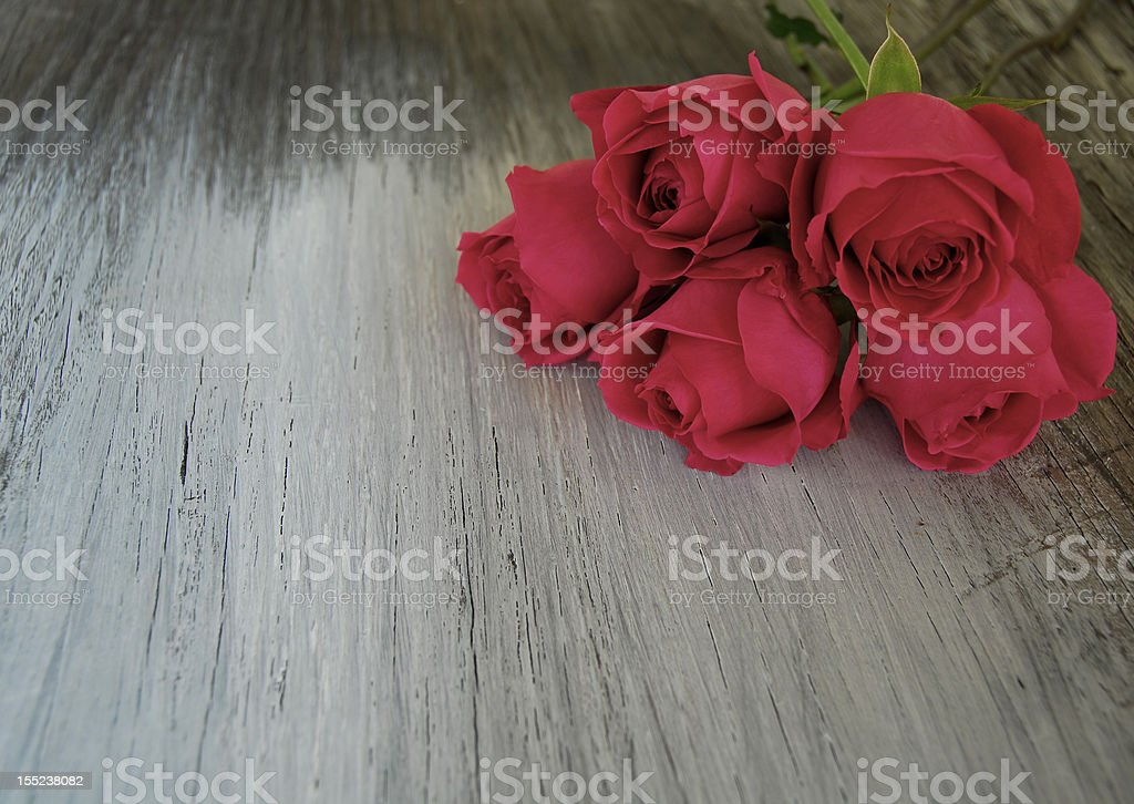 Bouquet of Roses on whitewashed wood stock photo