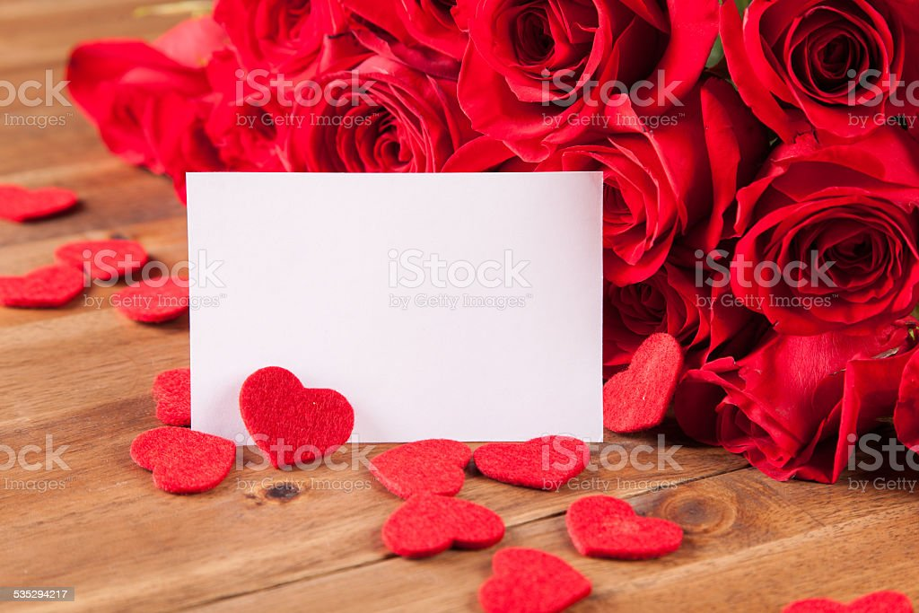 Bouquet of roses on wooden desk stock photo