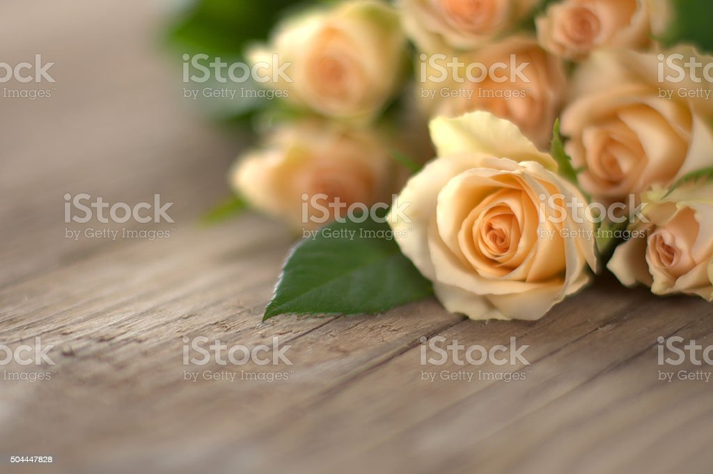 Bouquet of roses on wooden ground stock photo