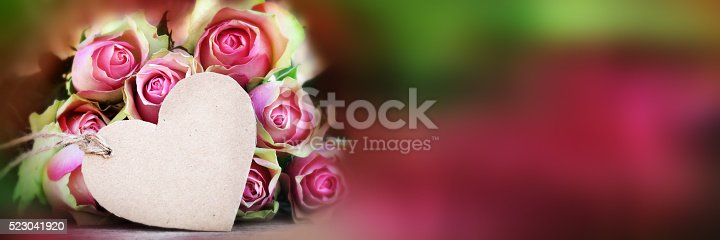 638784780 istock photo Bouquet of roses with a greeting card 523041920