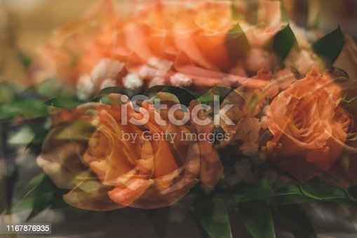 1129427811 istock photo Bouquet of roses with double exposure abstract background 1167876935
