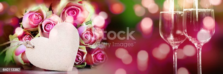 istock Bouquet of roses with heart and champagne 640113382